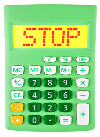 Calculator with STOP on display isolated on white background photo