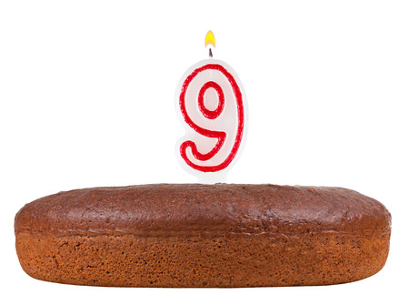 9th: birthday cake with candles number 9 isolated on white background