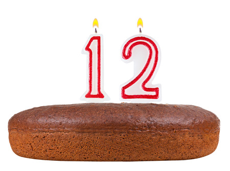 number 12: birthday cake with candles number 12 isolated on white background