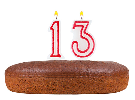 number 13: birthday cake with candles number 13 isolated on white background