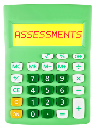 assessments: Calculator with assessments on display isolated on white background Stock Photo