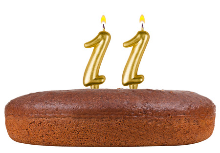 11 number: birthday cake with candles number 11 isolated on white background Stock Photo