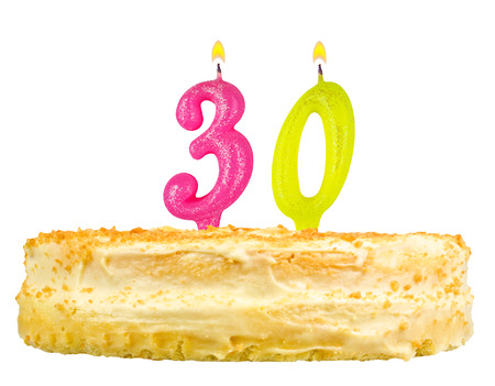 thirty: birthday cake with candles number thirty isolated on white background Stock Photo