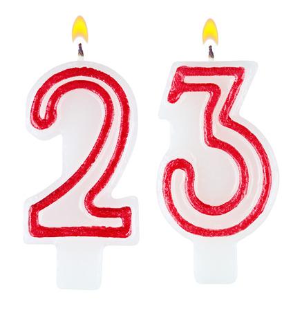 Birthday candles number twenty three isolated on white photo