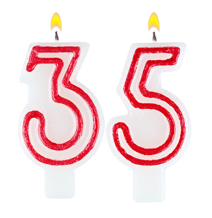 Birthday candles number thirty five isolated on white background photo
