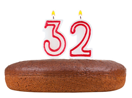 fancy pastry: birthday cake with candles number 32 isolated on white background