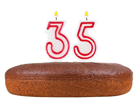 35th: birthday cake with candles number 35 isolated on white background Stock Photo