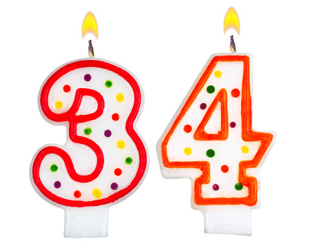 Birthday candles number thirty four isolated on white background photo