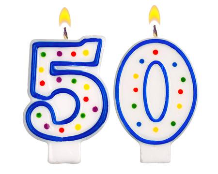 velas de cumpleaños: Velas en su cumpleaños número cincuenta aislados en fondo blanco Foto de archivo