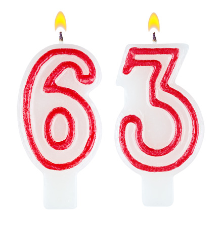 Birthday candles number sixty three isolated on white background photo