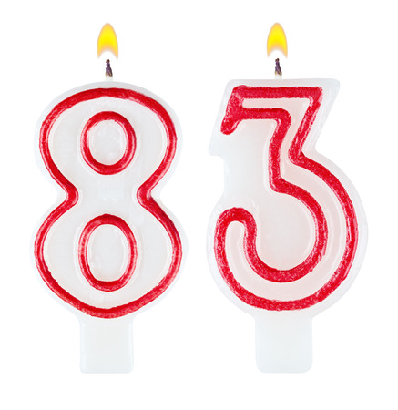 Birthday candles number eighty three isolated on white background photo