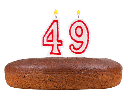 fancy pastry: birthday cake with candles number 49 isolated on white background Stock Photo