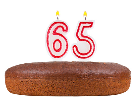 65th: birthday cake with candles number 65 isolated on white background Stock Photo