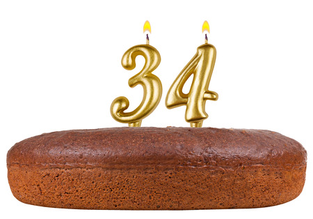 34: birthday cake with candles number 34 isolated on white background