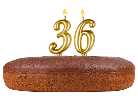 number 36: birthday cake with candles number 36 isolated on white background