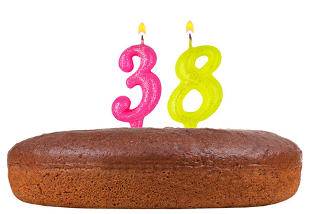 birthday cake with candles number 38 isolated on white background