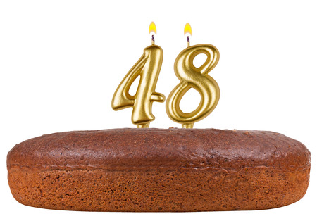 48: birthday cake with candles number 48 isolated on white background