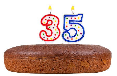 thirty five: birthday cake with candles number thirty five isolated on white background