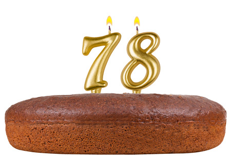 gold age: birthday cake with candles number 78 isolated on white background