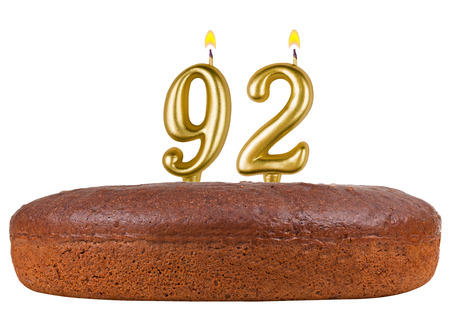 92: birthday cake with candles number 92 isolated on white background Stock Photo