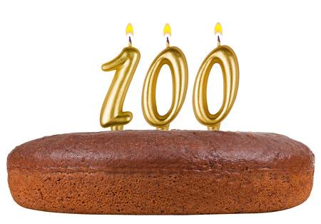 fancy pastry: birthday cake with candles number 100 isolated on white background