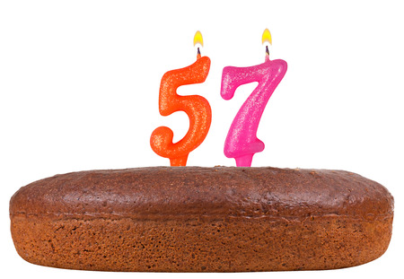 57: birthday cake with candles number 57 isolated on white background