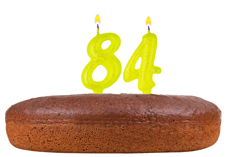 fancy pastry: birthday cake with candles number 84 isolated on white background