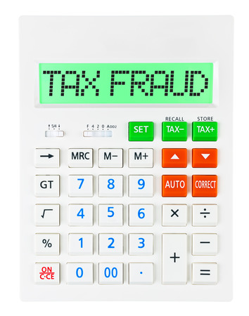 taxpayers: Calculator with TAX FRAUD on display on white background Stock Photo