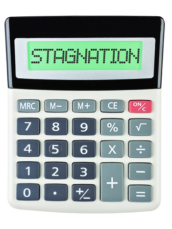 Calculator with STAGNATION on display isolated on white background Stock Photo