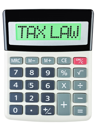 tax law: Calculator with TAX LAW on display on white background