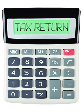 budgetary: Calculator with TAX RETURN on display isolated on white background Stock Photo