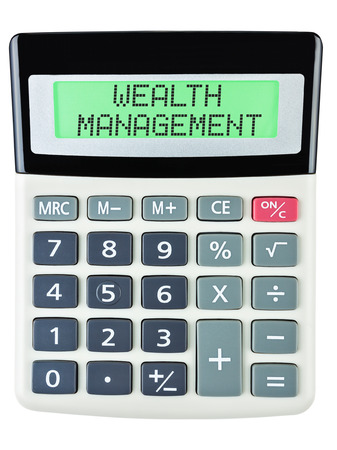 budgetary: Calculator with WEALTH MANAGEMENT on display isolated on white background Stock Photo