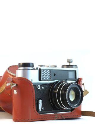 Retro old photo camera in leather case