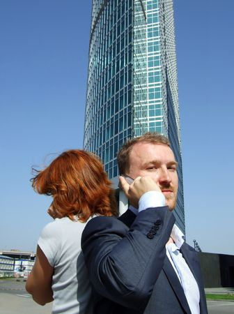 Man at the office building speaking phone