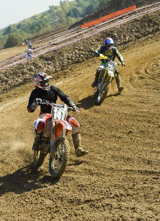 motorsprot: Two motocross riders duelling at turning point Stock Photo