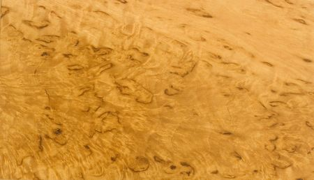 Varnished Karelian birch texture - rare beautiful wood Standard-Bild