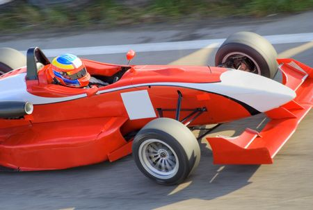 Red racing formula car in motion