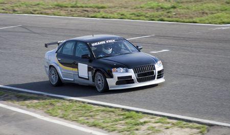 sportcar: Silver-deep-blue sportcar in a circuit race