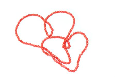Two hearts made of red beads, love concept Standard-Bild