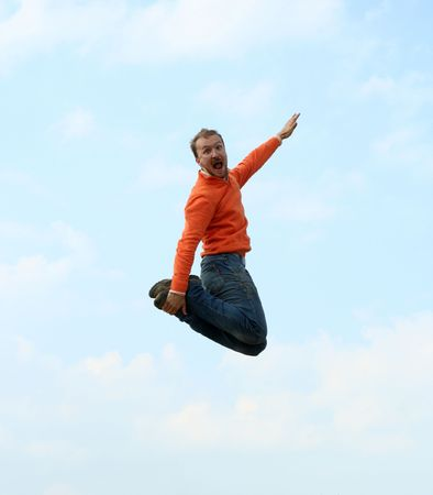 happy expressive man jumping high and screaming