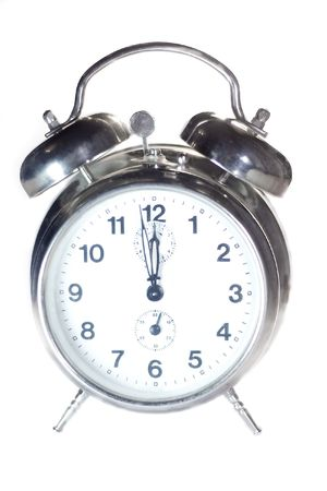 clang: classical alarm clock on white background Stock Photo