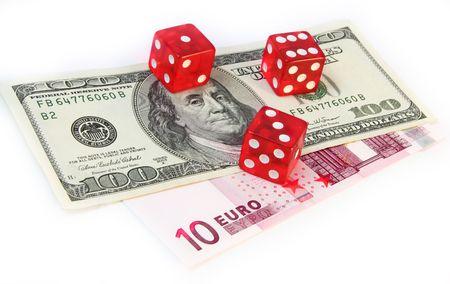 paper money and devil's bones on white background Standard-Bild