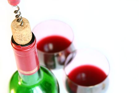Corkscrew and red wine bottle. Room for text in upper right corner Standard-Bild