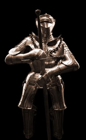 Knight's armour isolated on black background