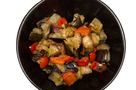 Eggplants and pepper with garlic, onion and soy sause on white background, chinese recipe Standard-Bild