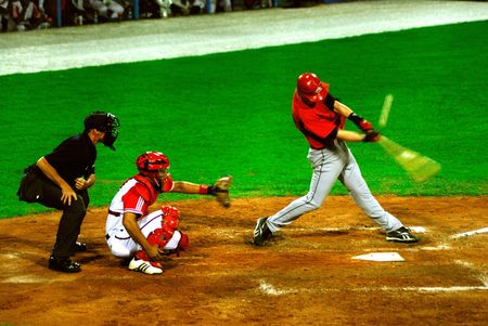 contestant: Game bettwen canada and cuba in the baseball worldcup 2009(5 september).Catching the ball was Ariel Pestano,the regular catcher in the game,(and of the cuban team)Cuba was the winner,5x1,