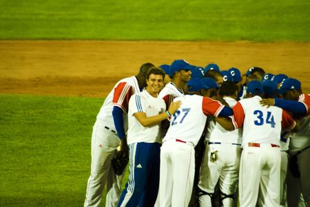 Cuba-Canada semifinal game .5september2009.After the game the players celebrates the victory(5x1).in the picture doctor Antonio Castro,soon of the cuban historical leader FIdel Castro .