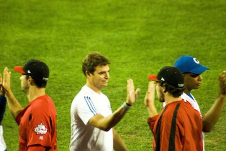 l plate: Cuba-Canada semifinal game .5september2009.After the game the two teams shake hands.In the midle of the picture the doctor Antoino Castro,soon of the historical leader Fidel Castro and member of the cuban delegation.