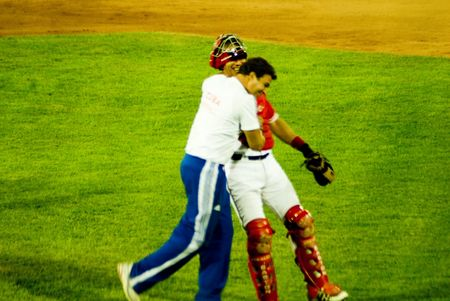 ballplayer: Cuba-Canada semifinal game .5september2009.After the game the Catcher Ariel pestao and the doctor Antonio Castro,soon of the cuban historical leader FIdel Castro celebrates the victory(5x1)of the cuban team.