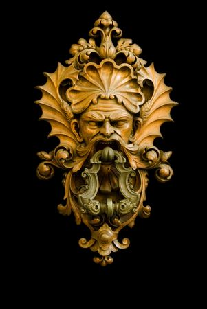 Doorknocker isolate in a black background Stock Photo